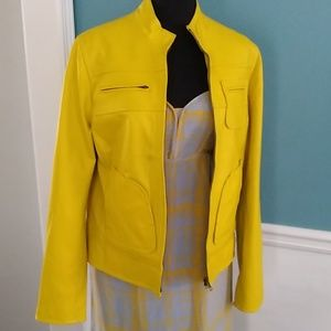 Yellow/ Green leather jacket.
